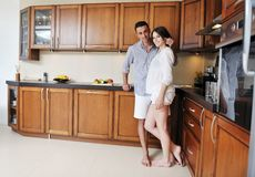 Happy young couple have fun in modern kitchen Royalty Free Stock Image