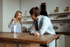 Happy young couple have fun in modern kitchen indoor royalty free stock photography