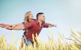 happy young couple have fun at wheat field in summer, happy future concept royalty free stock images