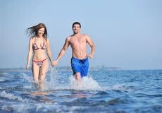 Happy young couple have romantic time on beach Stock Images