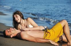 Happy young couple have romantic time on beach Royalty Free Stock Image