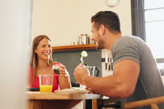 Happy young couple having breakfast Royalty Free Stock Photography