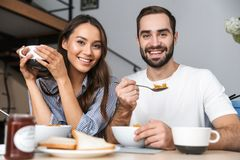 Happy young couple having breakfast stock photos