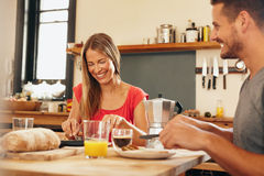 Happy young couple having breakfast together Royalty Free Stock Image