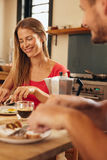 Happy young couple having breakfast together in kitchen Stock Photo