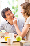 Happy Young Couple Having Breakfast Stock Photo