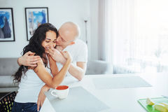 Happy young couple having coffee in the kitchen Stock Image
