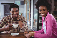 Happy young couple having coffee Stock Images