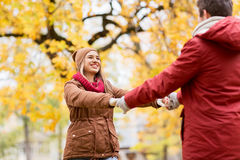 Happy young couple having fun in autumn park Stock Photography