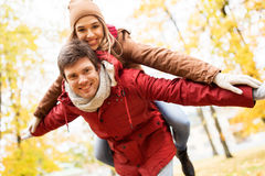 Happy young couple having fun in autumn park Royalty Free Stock Photo