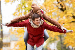Happy young couple having fun in autumn park Stock Image