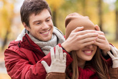 Happy young couple having fun in autumn park Royalty Free Stock Images