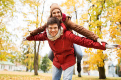 Happy young couple having fun in autumn park Stock Images