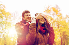Happy young couple having fun in autumn park Royalty Free Stock Photography
