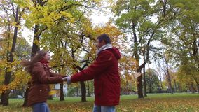 Happy young couple having fun in autumn park stock footage