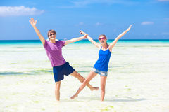 Happy young couple having fun on the beach Stock Images