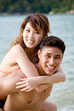 Happy young couple having fun on the beach Stock Photography