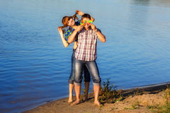Happy and young couple having fun on the beach. Summer vacation. Stock Photos