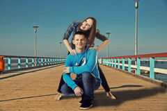 Happy young couple having fun on the bridge Stock Photos