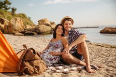 Happy young couple having fun camping at the beach Royalty Free Stock Photo