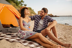 Happy young couple having fun camping at the beach Stock Images