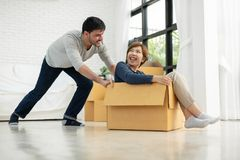 Happy Young couple having fun with cardboard boxes stock photography