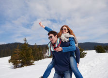 Happy young couple having fun on fresh show on winter vacation Royalty Free Stock Images