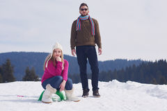 Happy young couple having fun on fresh show on winter vacation Stock Images