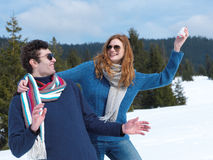 Happy young couple having fun on fresh show on winter vacation Royalty Free Stock Photos