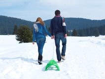 Happy young couple having fun on fresh show on winter vacation Royalty Free Stock Photography