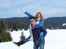 Happy young couple having fun on fresh show on winter vacation Royalty Free Stock Image