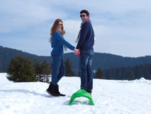 Happy young couple having fun on fresh show on winter vacation Stock Photography