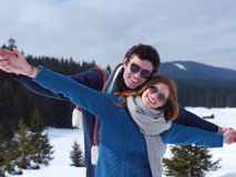 Happy young couple having fun on fresh show on winter vacation Stock Photo