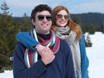 Happy young couple having fun on fresh show on winter vacation Stock Photos