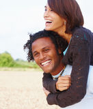 Happy young couple having fun outdoors Royalty Free Stock Photography