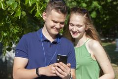 Happy young couple having fun outdoors together royalty free stock image