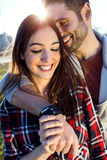 Happy young couple having fun in a park. Stock Image