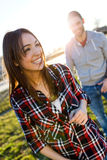 Happy young couple having fun in a park. Royalty Free Stock Images