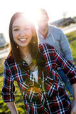 Happy young couple having fun in a park. Royalty Free Stock Photos