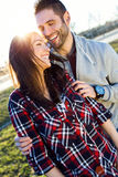 Happy young couple having fun in a park. Royalty Free Stock Image