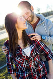 Happy young couple having fun in a park. Stock Photo