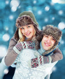 Happy young couple having fun playing outdoors in winter Royalty Free Stock Photography