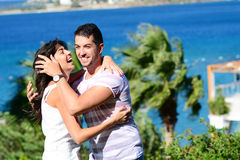 Happy young couple having fun on a sea background Royalty Free Stock Image