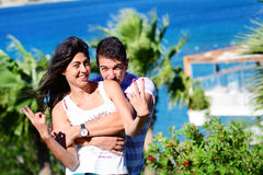Happy young couple having fun on a sea background Royalty Free Stock Photos