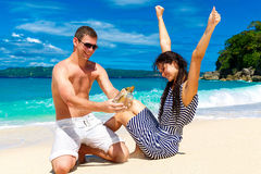 Happy young couple having fun on the shore of a tropical island. Royalty Free Stock Photo