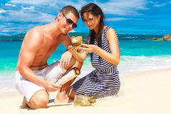 Happy young couple having fun on the shore of a tropical island. Royalty Free Stock Photography