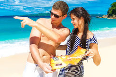 Happy young couple having fun on the shore of a tropical island. Stock Photo