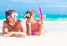 Happy young couple having fun snorkeling,  lying Royalty Free Stock Image