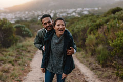 Happy young couple having fun on their countryside trip Royalty Free Stock Images