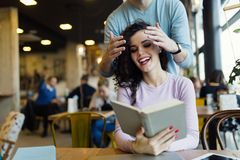 Happy young couple having fun in coffee shop Royalty Free Stock Photography